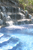 Poool and waterfall at montezuma beach houses